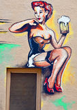 Mural barmaid. GLOBE ARIZONA APRIL 13 2014: Mural barmaid in Globe is a very small copper mining town and this was painted on the side of a brick building Stock Image