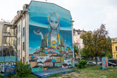 Mural on the building on the Andriyivskyy Descent. Ukraine, Kyiv, Podil. Ed Royalty Free Stock Photography