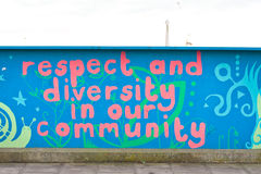 Mural. CAMBRIDGE, UK - JANUARY 25, 2014:  A painted mural on Mill Road, Cambridge, celebrating the diverse community in the area Royalty Free Stock Photos