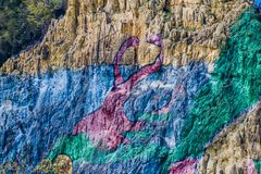Mural DE La Prehistoria The Muurschildering van Voorgeschiedenis schilderde op een klippengezicht in de Vinales-vallei, Cuba stock fotografie