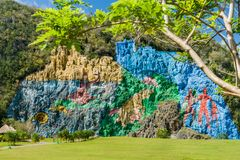 Mural de la Prehistoria The Mural of Prehistory painted on a cliff face in the Vinales valley, Cuba royalty free stock images