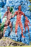 Mural de la Prehistoria The Mural of Prehistory painted on a cliff face in the Vinales valley, Cuba stock image
