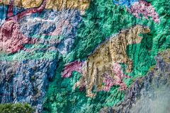 Mural de la Prehistoria The Mural of Prehistory painted on a cliff face in the Vinales valley, Cuba stock images
