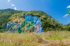 Mural de la Prehistoria The Mural of Prehistory painted on a cliff face in the Vinales valley, Cuba stock photography