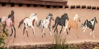 Mural depicting wild painted horses on walls of Taos royalty free stock photography