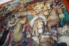 Mural by Diego Rivera, Mexico. The details of Diego Rivera's mural depicting Mexico's history, at the National Palace in Mexico City. Diego Rivera was a Stock Photos
