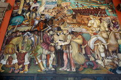 Mural by Diego Rivera, Mexico. The details of Diego Rivera's mural depicting Mexico's history, at the National Palace in Mexico City. Diego Rivera was a Stock Images