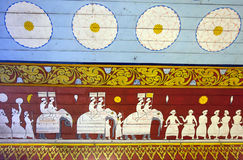 A mural on the entrance wall to the Temple of the Sacred Tooth Relic in Kandy, Sri Lanka. A mural depicting a perahera (Buddhist procession) on the entrance stock photography
