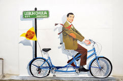 A mural of the famous Mr. Bean character on a bicycle Stock Images