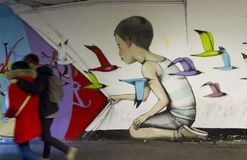 Mural from French Painter Seth Globepainter. ROME, ITALY - DECEMBER 31 2014: Mural from French Painter Seth Globepainter in Rome metro station, with a couple Royalty Free Stock Photography