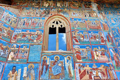 Mural Fresco Facade at Voronet Monastery. Ancient mural painted facade fresco at Voronet Monastery, Romania Stock Photo