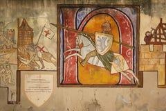 mural Geschilderde muur die een ridder afschilderen Carcassonne frankrijk royalty-vrije stock afbeeldingen