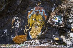 Mural of Guru Rinpoche and deities in cave , Bhutan royalty free stock images