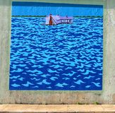 Mural Of A House In The Middle Of The Sea On A Bridge Underpass on James Road in Memphis, Tennessee. Stock Photo