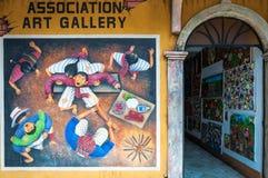 Mural inspired by Mayan culture and traditions at an art shop in Guatemala. San Juan La Laguna, Guatemala -March 1, 2016: Mural depicting aspects of Mayan Stock Photos