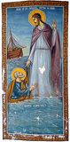 Jesus and St Peter on the Sea of Galilee on Romanian church. Painted on the wall of a Romanian church in Bucharest, a mural of Jesus and the apostle on the Sea stock photo