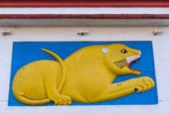 Mural of lion at Shree Omkareshwara Temple, Madikeri India. Madikeri, India - October 31, 2013: Shree Omkareshwara Temple. Mural of yellow lying male lion on Royalty Free Stock Photography