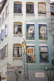 Mural, Mulhouse, Alsace, France. Famous mural, downtown Mulhouse representing windows and a painter painting in green the facade Stock Photos
