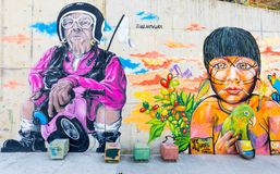 mural with old man and with young Colombian native from the thirteenth quarter in Medellin stock photography