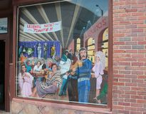 Mural Outside of Legends Live Music Corner Downtown Nashville. What do the five original 78RPM Elvis Presley Sun Records, a set of KISS Dolls and a 12 string Stock Image
