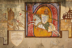 Mural. Painted wall depicting a knight. Carcassonne. France. Detail of a painted wall depicting a medieval knight Raymond Trencavel.  Carcassonne. France Royalty Free Stock Images