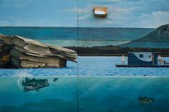 Mural painting of a lake with a hole in the wall royalty free stock photography
