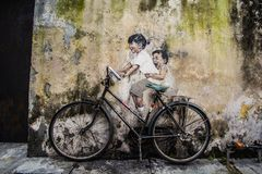 Mural in Penang. A Mural by Ernest Zacharevic is a young Lithuania-born artist who has become exceedingly popular in Penang after completing a series of royalty free stock photo
