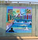 Mural Of People Swimming And Splashing In A Pool On A Bridge Underpass On James Rd in Memphis, Tn Stock Photography