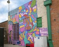 `Cake` by Gabriel McCool and `Free Vzla` by Alejandra Lara Camargo, Deep Ellum, Texas. In the mural pictured we see the left half of `Cake` by Gabriel McCool and Royalty Free Stock Image
