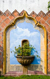 Mural and plant on wall Royalty Free Stock Images