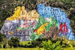 Mural of Prehistory in Vi�ales valley view in Cuba. Unreal nature with lakes, mountain, trees, wildlife. Gorgeus sky. stock image