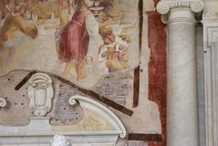 Mural repair. An ancient mural is being repaired and replaced showing the materials behind the artwork and the archway and door over which the mural will remain Stock Images