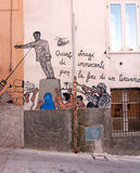 Mural of saddam hussein Statue In Orgosolo. The statue of Iraqi dictator Saddam Hussein was toppled at  2003 in Baghdad Royalty Free Stock Photography