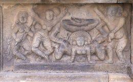 Mural sculpture of acrobatic dancing. Stock Images