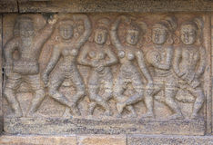 Mural sculpture of group dancing women. Stock Photography