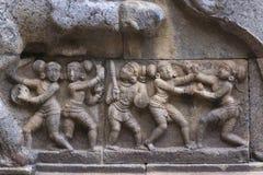 Mural sculpture of warriors. Stock Images