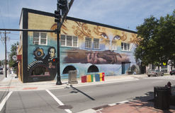Mural Showing Multiracial Hands Holding Each Other in Unity and Support. Outdoor mural on the side of a building showing racial unity and support in Durham stock images
