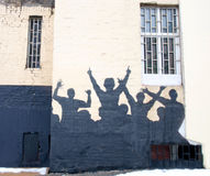 Mural with silhouettes of people at the concert Royalty Free Stock Photography