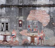 Mural in Songkhla old town, Songkhla, Thailand. SONGKHLA, THAILAND - MAY 15, 2015: An old concrete wall of the former tea shop named 'Fu Chao' built in 1919 in Stock Photo
