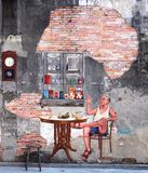 Mural in Songkhla old town, Songkhla, Thailand. SONGKHLA, THAILAND - MAY 15, 2015: An old concrete wall of the former tea shop named 'Fu Chao' built in 1919 in Royalty Free Stock Photos