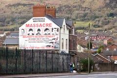 Mural of Springhill westrock massacre. BELFAST, NORTHERN IRELAND - FEB 9, 2014: Mural of Springhill westrock massacre on Springfield Road in Belfast, Northern Stock Photography
