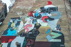 Mural street art by unidentified artist in jewish quarter Kazimierz. Stock Photos