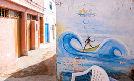 Mural on tea shop wall,Taghazout surf village,agadir,morocco 2. A mural of a surfer on a wave dreaming about mint tea on the wall of a tea shop by the sea Stock Photography