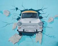 Mural of Trabant car breaking through the Berlin Wall at East Si stock photos