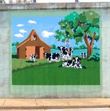 Mural Of A Young Blonde Girl Riding A Dairy Cow On A Bridge Underpass On James Rd in Memphis, Tn Stock Images