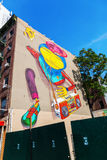 Murale dell'OS Gemeos in Manhattan del centro, NYC Fotografia Stock
