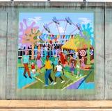 Murale delle famiglie ad un parco di divertimenti su un sottopassaggio del ponte su James Rd a Memphis, Tn Immagini Stock