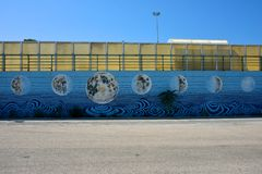Murales on a wall with paint of moon`s phases. Murales on a wall in Argostoli with paint of moon`s phases royalty free stock photos
