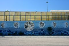 Murales on a wall with paint of moon`s phases. Murales on a wall in Argostoli with paint of moon`s phases stock images