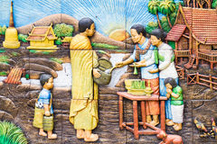 Muralist. Give alms to a Buddhist monk Royalty Free Stock Images